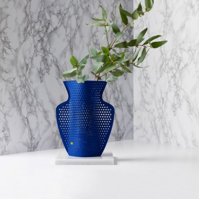 Perforated blue paper-vase